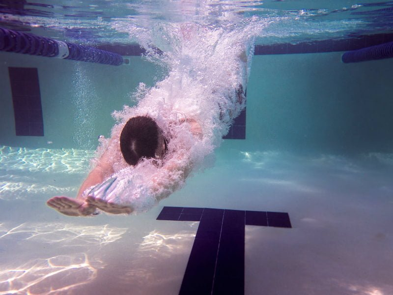 Diver or swimmer, diving in swimming pool