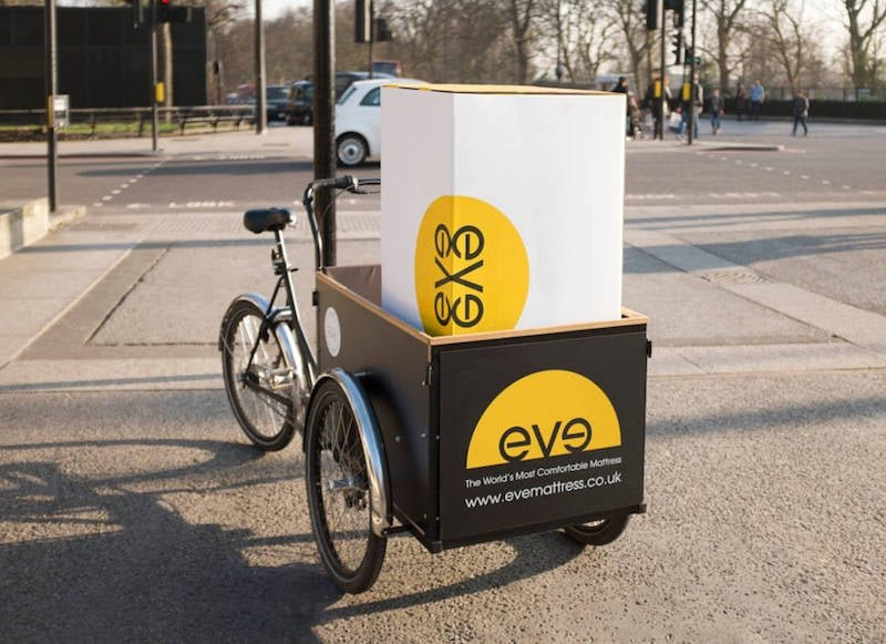 Eve's mattresses are compressed for delivery and can be transported by bicycle
